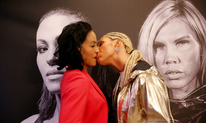 Boxer Mikaela Lauren kisses Cecilia Braekhus during face-off